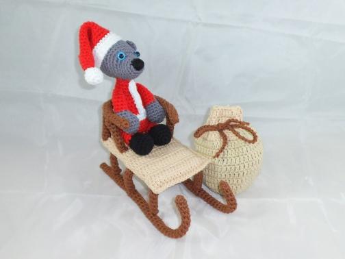 Weihnachtsmann-Teddy mit Schlitten und Sack