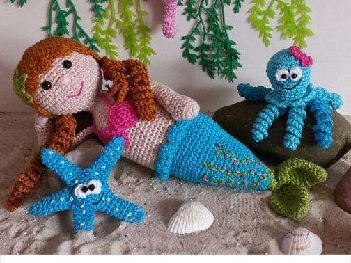 Meerjungfrau mit Meeresbewohnern