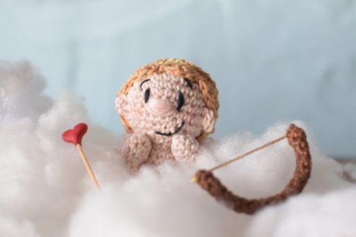 Amor oder der Liebesbote als Taschenbaumler...